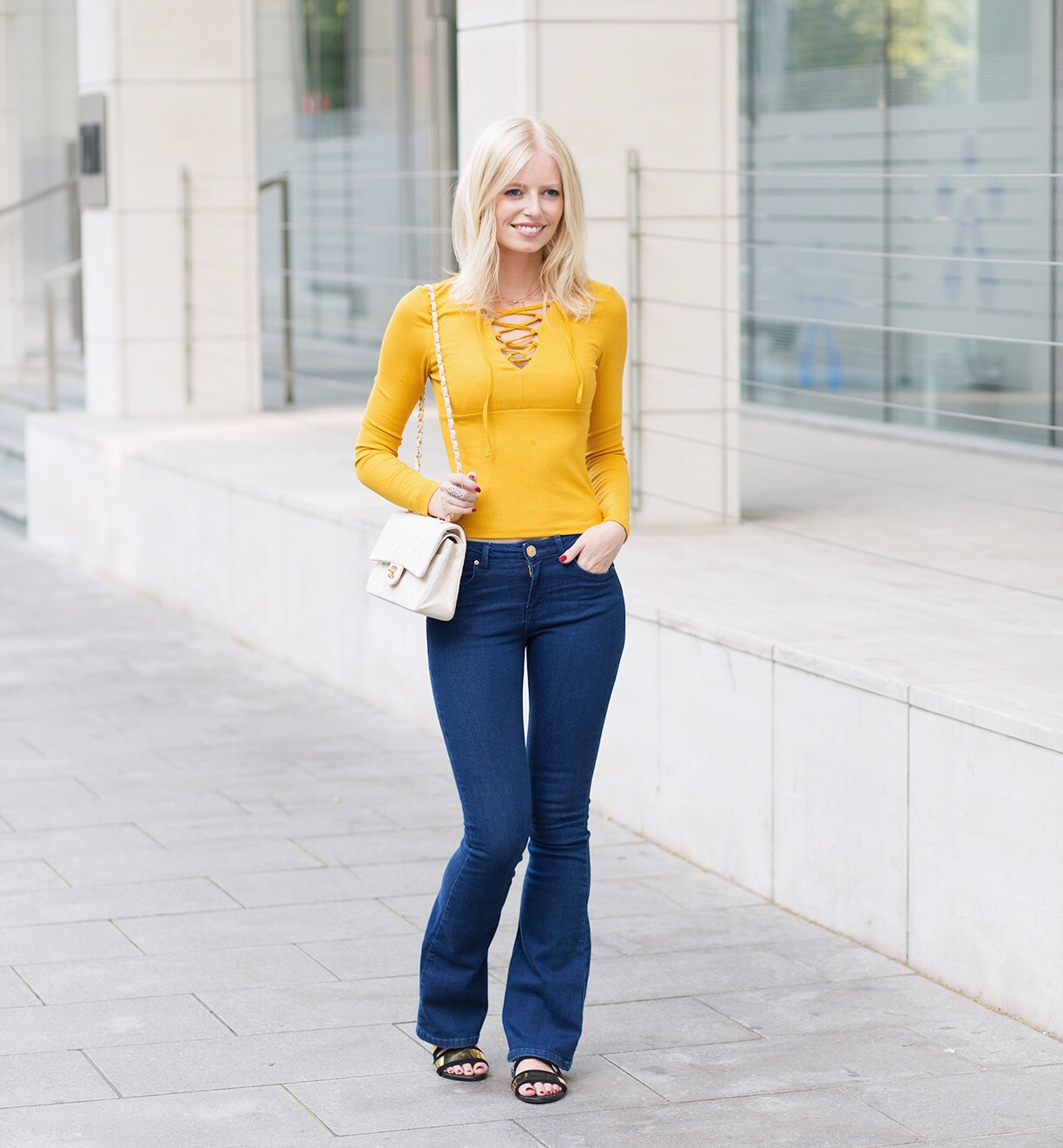 Image result for flared jeans with a fitted top